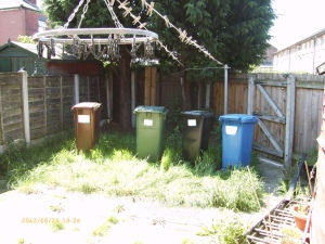 Not the new XFactor judges...the bins are flattening the grass to make it short enough to mow